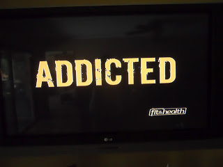 ADDICTED word on black background