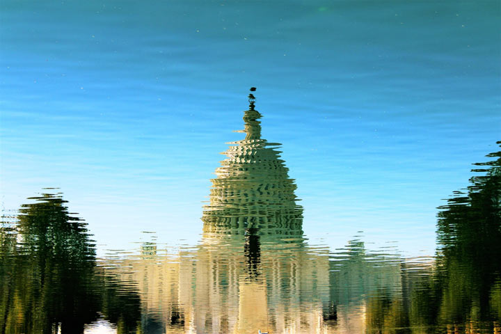 reflection of congress building in pond or lake