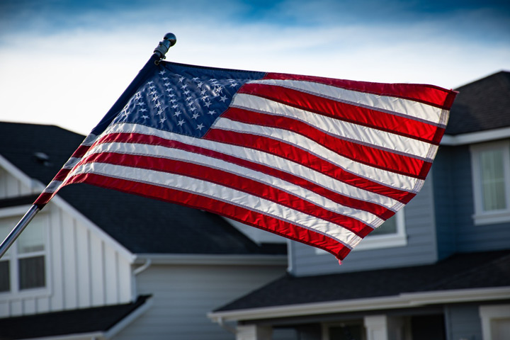 American flag flying at someone's home - war within