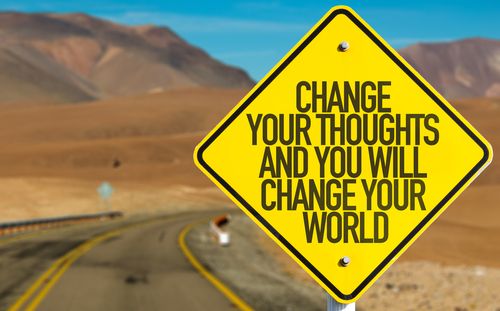 yellow road sign stating change your thoughts and you will change your world