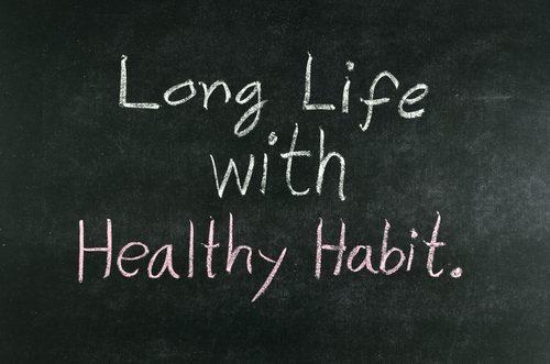 """words """"Long Life with Healthy Habit"""" written on chalkboard"""