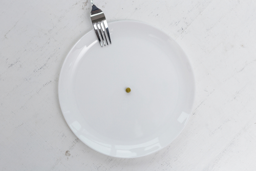 plate with only one pea on it
