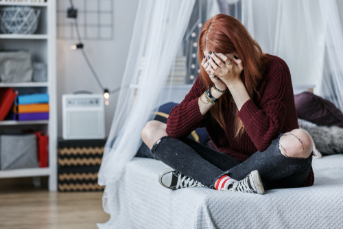 sad teenage girl in her room
