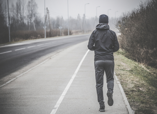 man walking or jogging in rainy weather