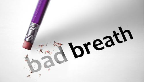 bad breath spelled out - bad being erased with pencil