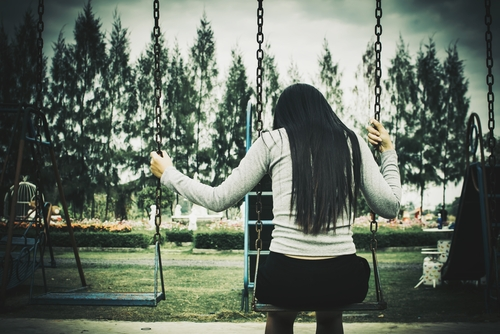 woman alone on swing set