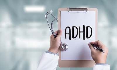 ADHD written on medical clipboard
