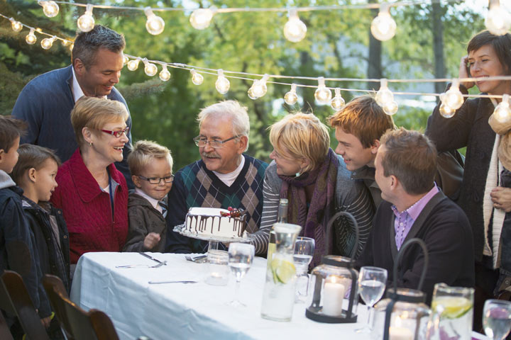 family gathering outdoors for birthday party - addiction and recovery