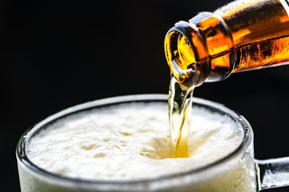 close up of beer pouring into mug
