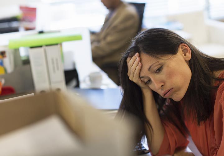 woman at office job looking stressed out - stress