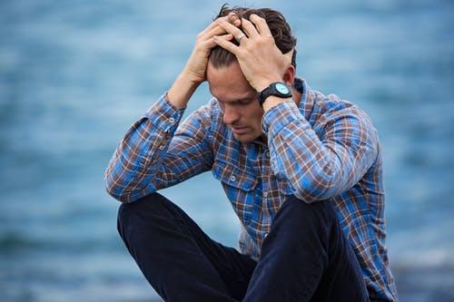 sad man at lake or beach
