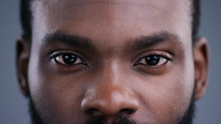 closeup of handsome Black man's face/eyes - BIPOC and mental health