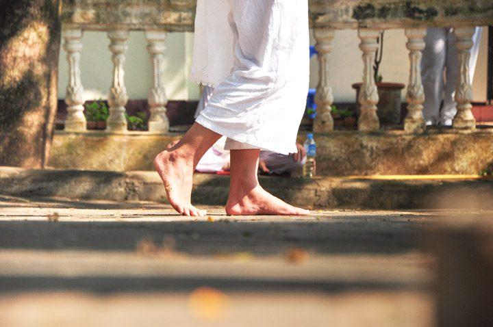cropped shot of person's feet walking outside barefoot - walking meditation - meditation styles