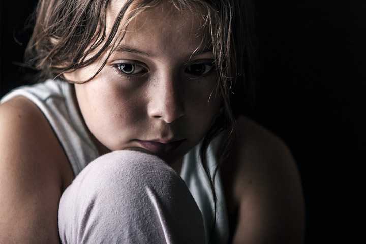 closeup of young child looking sad and fearful - adverse childhood experiences
